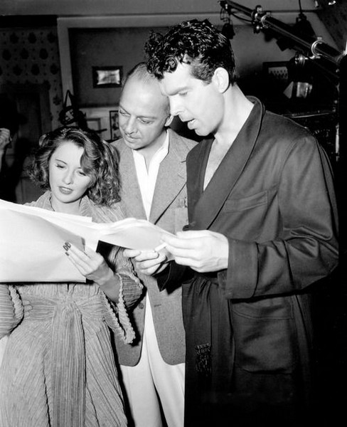 Remember the Night (1940) Directed by Mitchell Leisen Screenplay: Preston Sturges Shown on the set: Barbara Stanwyck, director Mitchell Leisen, Fred MacMurray